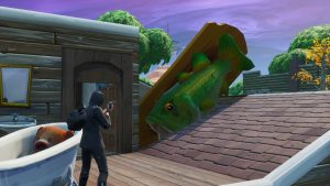 Fortnite - Visit an Oversized Phone, Big Piano, and Giant Dancing Fish Trophy
